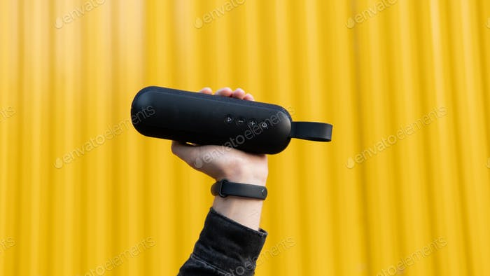 Portable modern sound on a yellow background