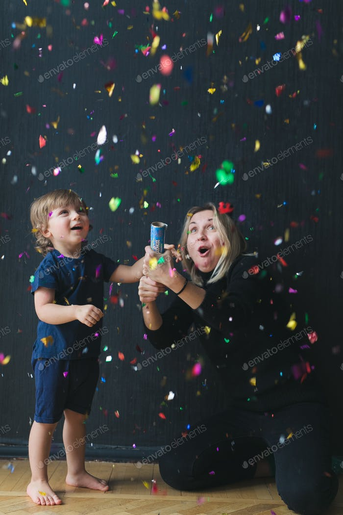 the whole house in confetti.  mom and son blow up firecrackers, rejoice and have fun.