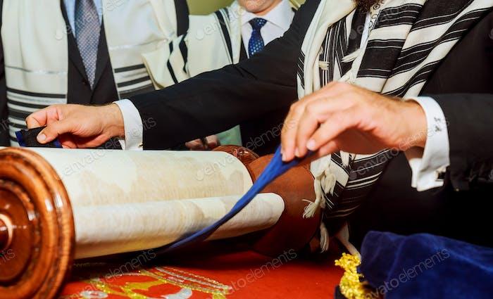 Barmitzvah reading Torah scrolls Holy city of Jerusalem on Holiday of 13th birthday of jew.
