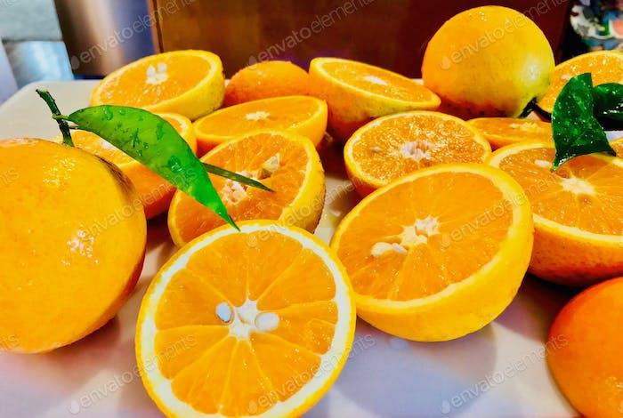 Real image, Big, bright, beautiful, bold, organic freshly cut oranges from my backyard orange tree