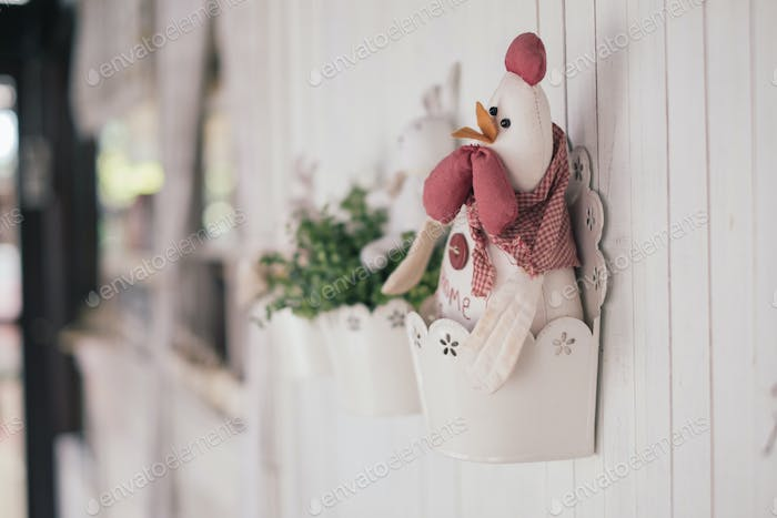 Chicken doll on the wall