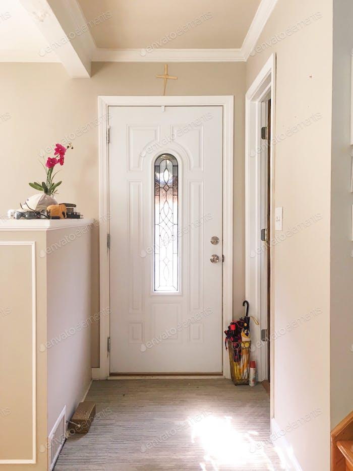 Sunlight shining through entry front door.