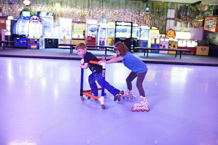 Kids at a roller-rink.