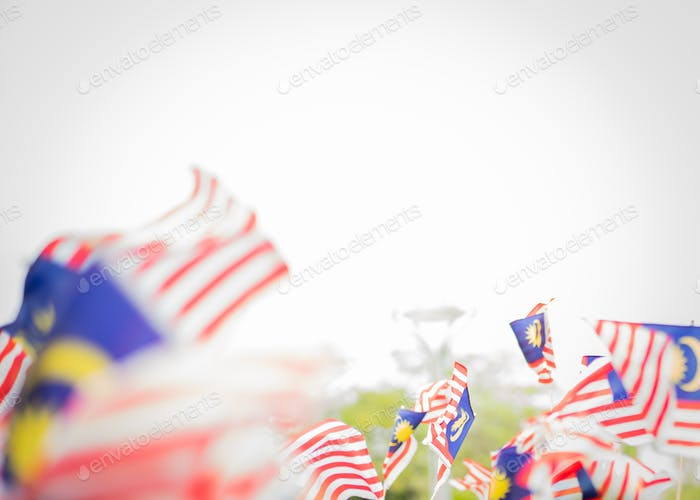 blurry malaysia flags waving on independence day