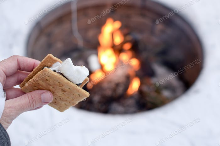 S'mores outside by a campfire in the winter