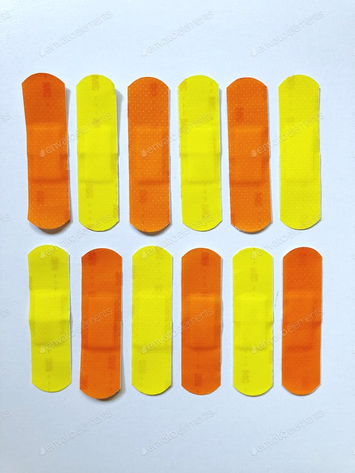 Bright, bold and colorful bandages (plasters). Vibrant colors of first aid.