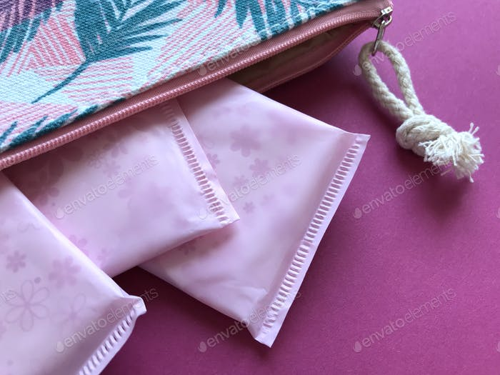 Women's Health : Menstruation. Sanitary pads in a  wash-bag