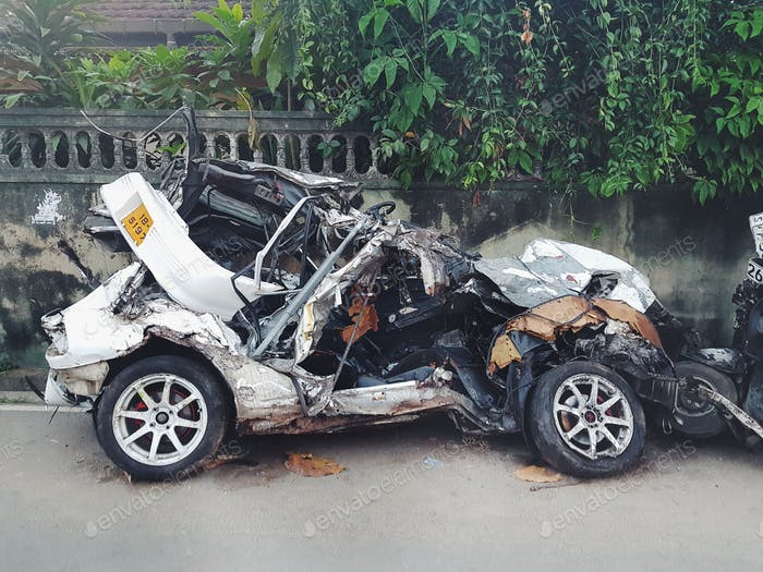 Crashed jumes car on the street