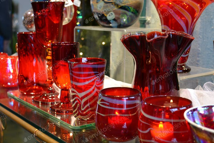 Row of red hand-blown glass goblets