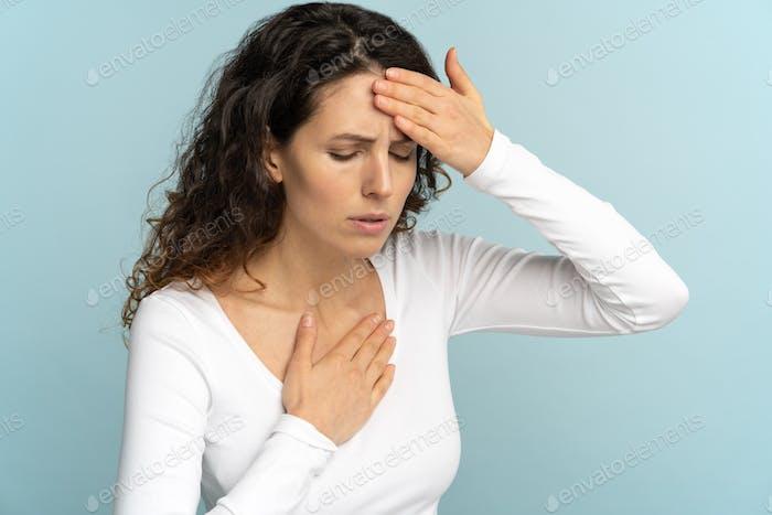 Woman received heatstroke in hot summer weather touching her forehead. Chest pain sun stroke dyspnea