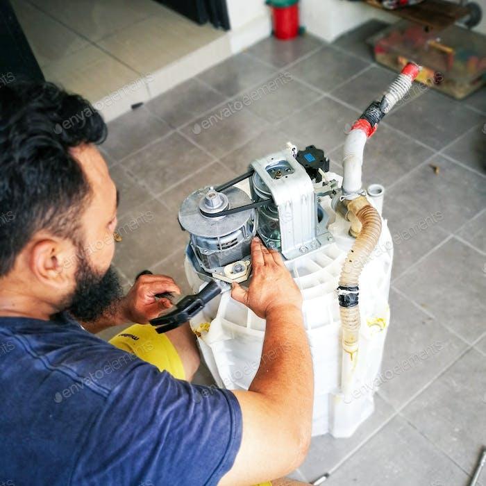 reparación de tambor de lavadora