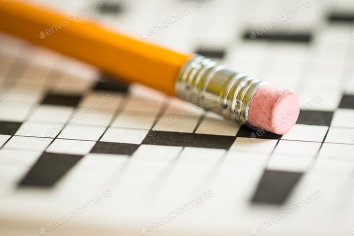 A Pencil on Top of a Crossword Puzzle
