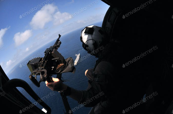 Helicopter Gunner View of an United States Naval Warship