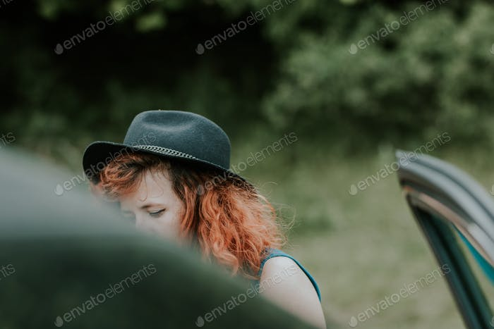 Girl with a hat in the nature
