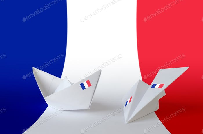 France flag depicted on paper origami airplane and boat. Oriental handmade arts concept
