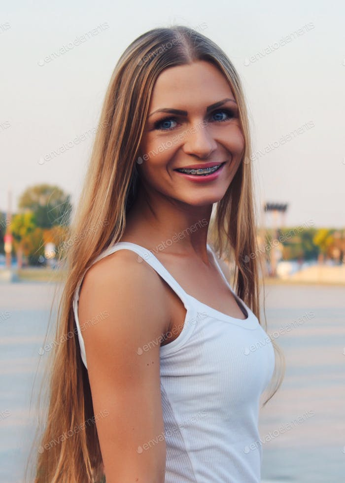 Girl in braces is smiling