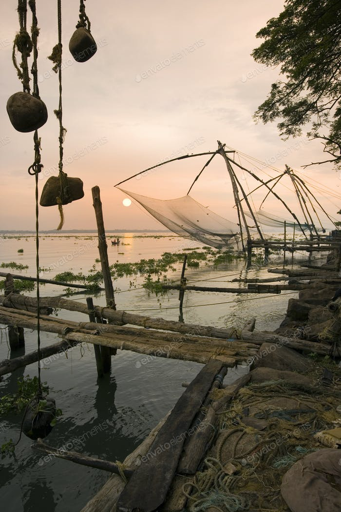 Chinese fishing nets at sunrise in the Fort Kochi area of Cochin in the Kerala region of southern