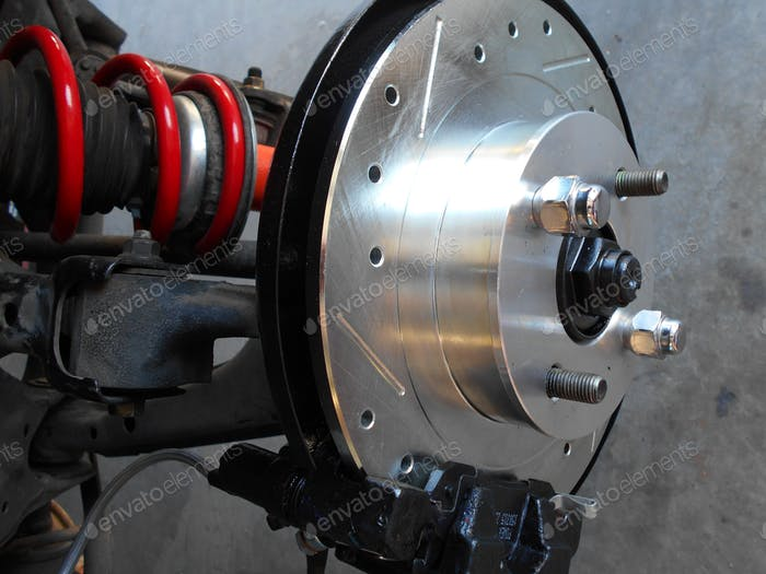 Car Repairs! Replacement rotors, brake pads, calipers and springs on an automobile.