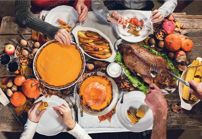 Family feasting of Thanksgiving day Roasted turkey