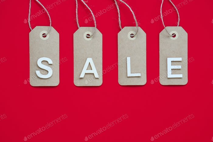 Price tags with a word sale on red background