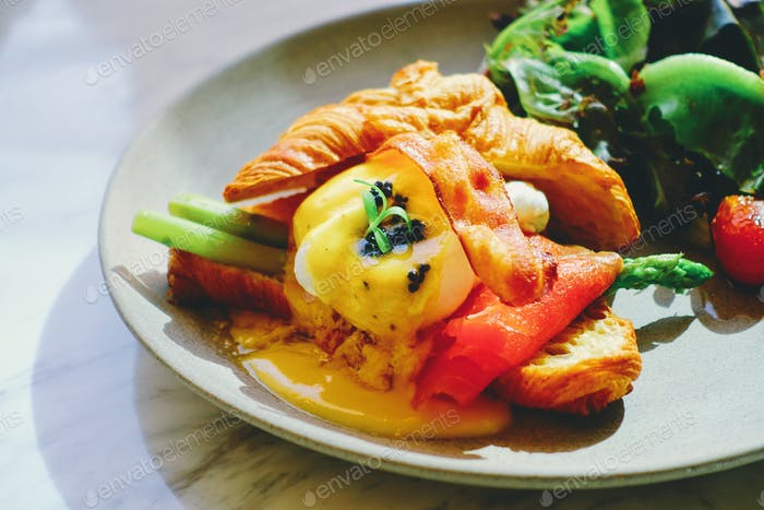 Egg Benedict with salmon and bacon croissant