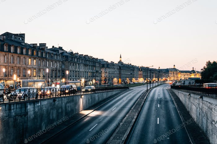 Traffic and lights in street at dusk. Bordeaux