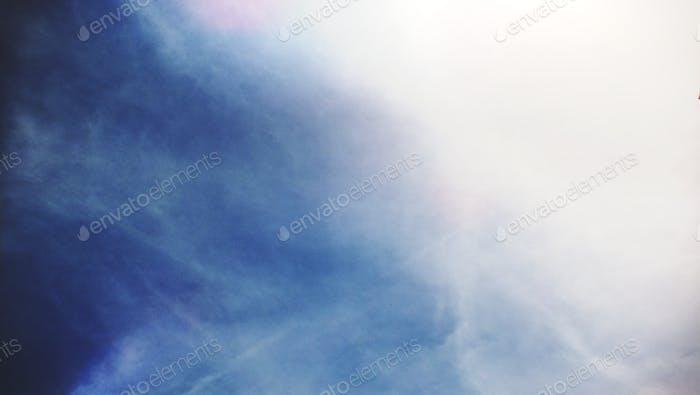 Blue cloudy sky gradient