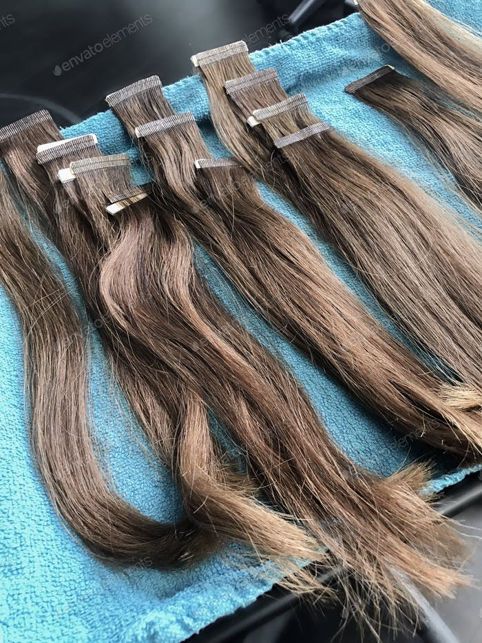 Hair extensions on a tray.