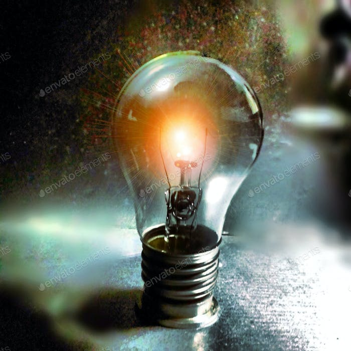 A light bulb shining brightly kicking up dust particles.  Ideas, Invention. Bright idea