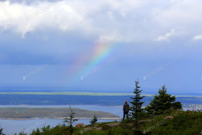 Acadia National Park. Bar Harbor ME. Tiny human enjoys a view filled with nature & a pretty rainbow