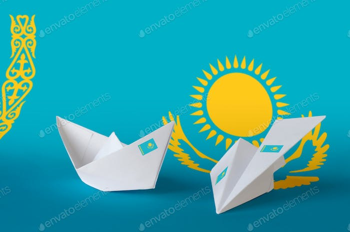 Kazakhstan flag depicted on paper origami airplane and boat. Oriental handmade arts concept