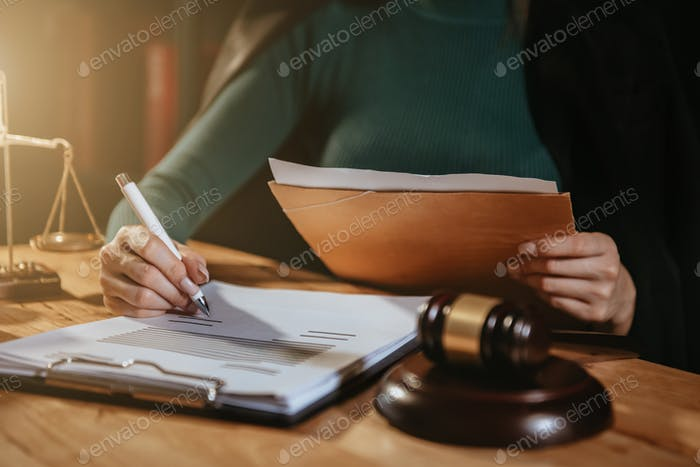 Lawyer  working with paperwork on his desk in office workplace for consultant.