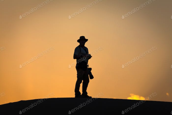 Silhouette of photographer (nominated on May 20)