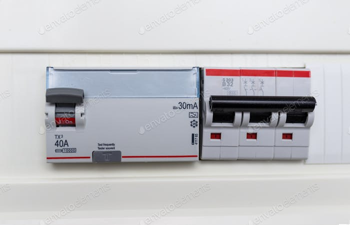 Automatic circuit breakers in a fuse box. Power control panel.