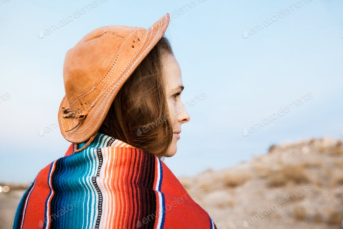 Portrait Of Woman Standing In Desert