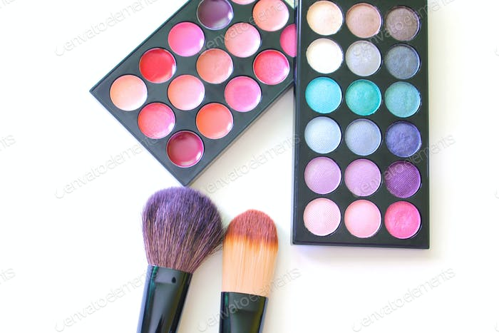Overhead view of makeup brushes, and makeup