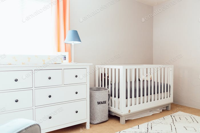 Interior decor of a baby nursery inside a cute, trendy, modern home.