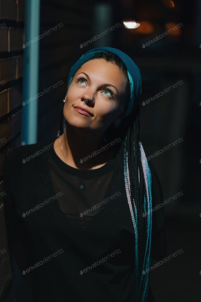 Portrait of girl with kanekalon blue hair at night