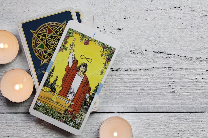Tarot cards and candles on a wooden table