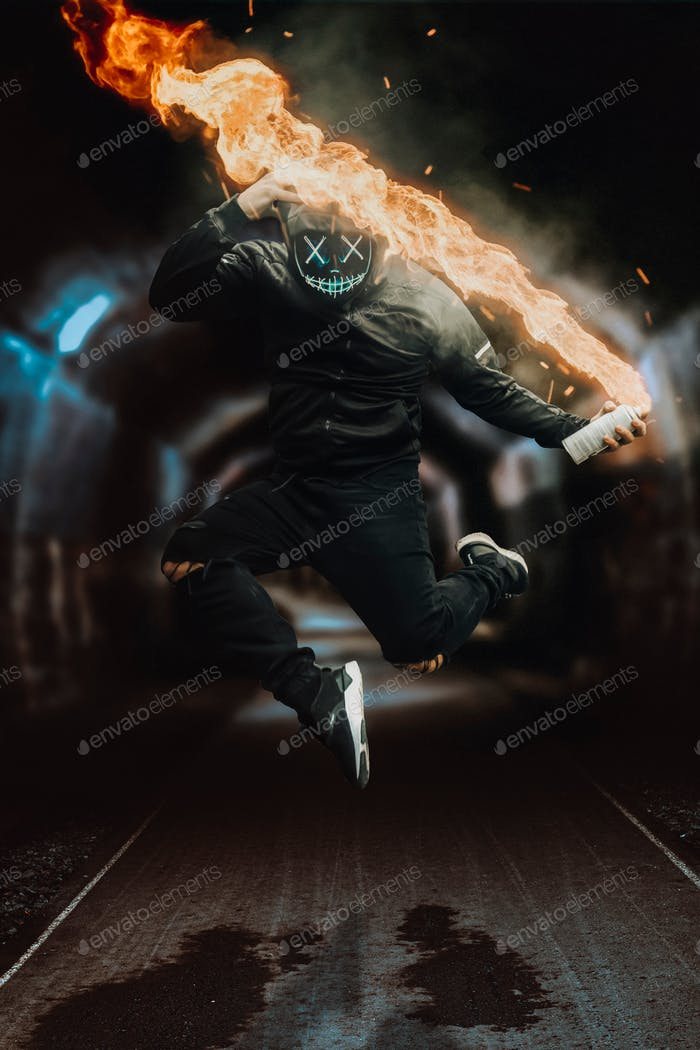 Man in black with light up mask jumping