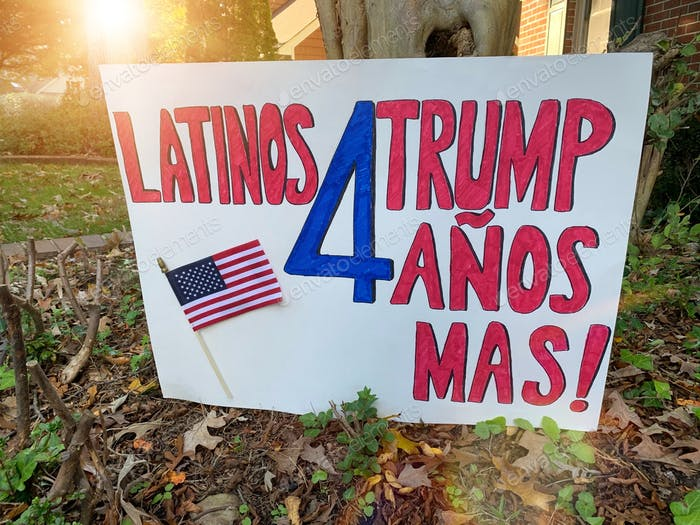 A Latinos for Trump 4 more years written in Spanish at a front lawn of a house days before elections