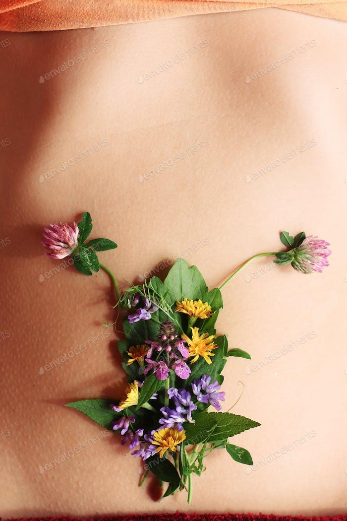 Women's health, wildflowers on belly