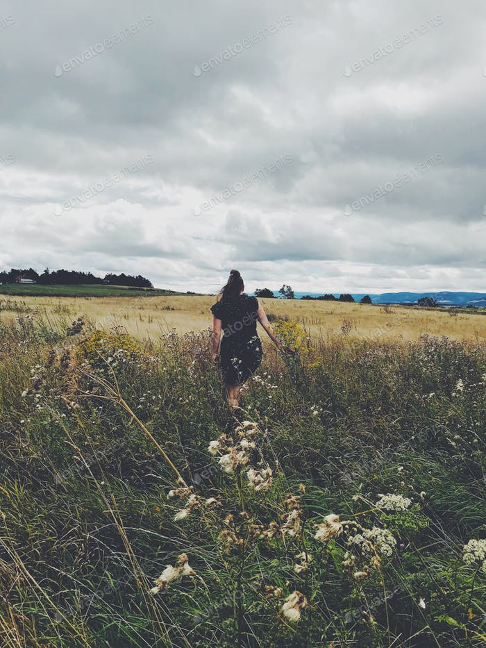 Woman walking through a field  - NOMINATED ☁️🙌🏼 -