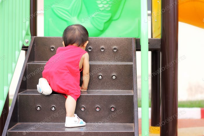 Baby crawling on the stairs.