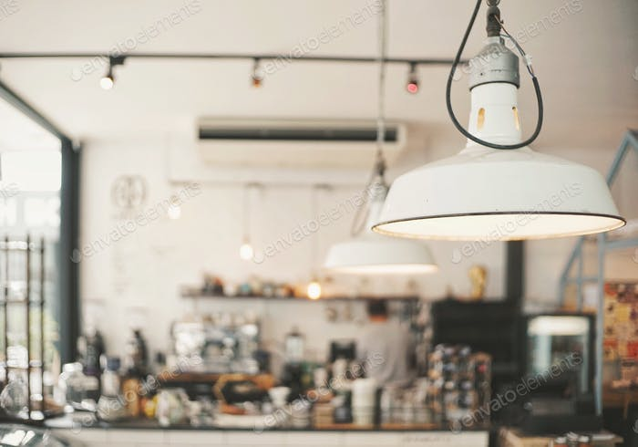 Cafe or coffee shop in blurred background with lighting equipment
