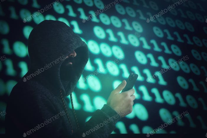 Man holding a cell phone against digital background