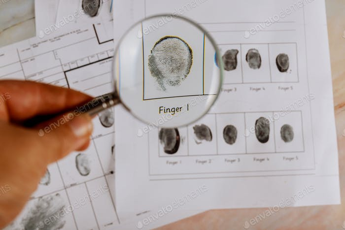 Criminal investigation, fingerprint card and magnifier arrest, accused, investigation