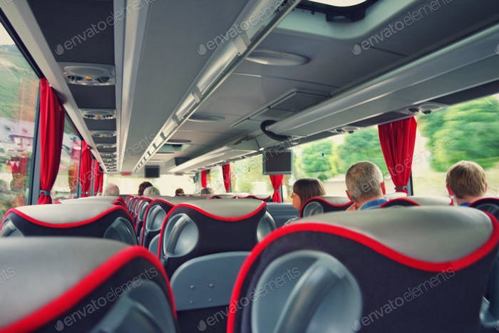 People traveling with the bus.