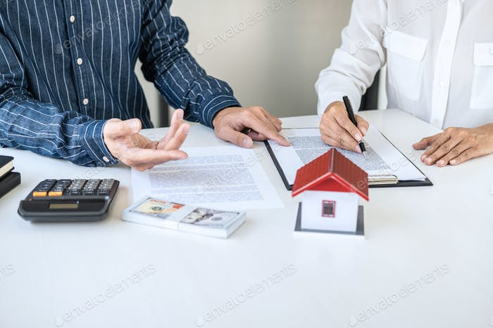 Real estate broker agent being analysis and making the decision a home estate loan to customer