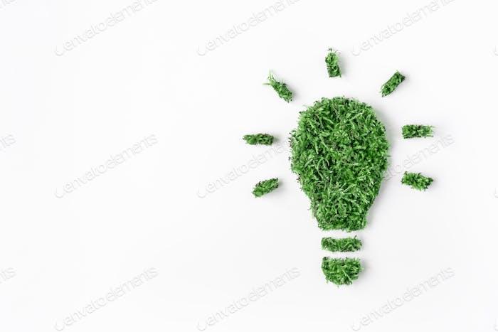Icono abstracto bombillas de hierba y hojas verdes sobre fondo blanco